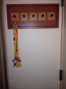 When I checked in and got settled, I hung my medal on my makeshift medal rack - the coat hooks!