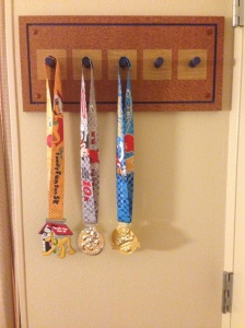 My makeshift medal rack in my room is starting to fill up! Three does done and one to go.