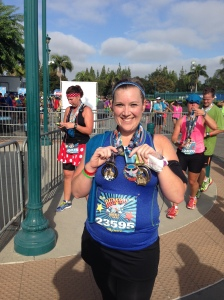 I finished the Disneyland half and collected the half marathon finisher's medal, the Dumbo Double Dare medal, and the Coast to Coast medal.