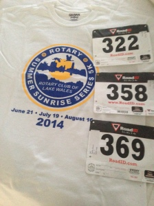 All three of my bibs and the race t-shirt for the Lake Wales Sunrise Series.