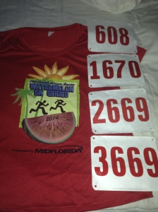 All four of my bibs from the Watermelon Series with the race t-shirt. The shirt is only given to runners who complete the series.