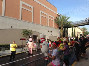 "The finish line at the I-Drive 5k had some ""characters"" including the King's Bowling Pin."