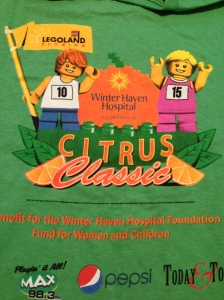 The race t-shirt for the Citrus Classic is a cotton t-shirt with a LegoLand design. My injured friend picked up my packet for me!