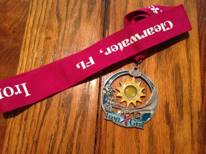 The finisher's medal for the Iron Girl half is very pretty and the sun in the middle spins.