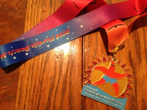 The finisher's medal for the Florida Beach Halfathon. They have some really cute medals for their races.