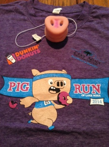 The race t-shirt and pig nose swag for the Lake Nona Pig run. The nose was a cute hair accessory for a few runners.