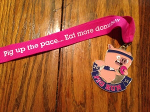 The medal for finishing the Lake Nona Pig Run. Pigs and doughnuts!