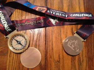 Finisher's medal for the Expedition Everest Challenge. It opens and is a compass.