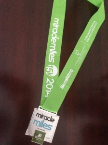 The finisher's medal for the Miracle Miles 15k.
