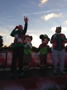 The race announcers with Mickey and Minnie at the start line.