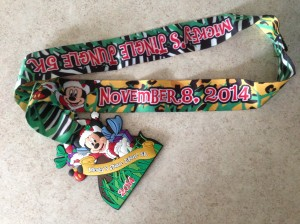 The official finisher's medallion for Mickey's Jingle Jungle 5k.