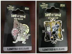Commemorative pins for the Happy Haunted 5k and Tower of Terror 10 Miler.