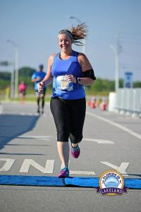 I selected this as my free race photo simply because my hair makes me giggle. And, yes, my phone is in my shirt.