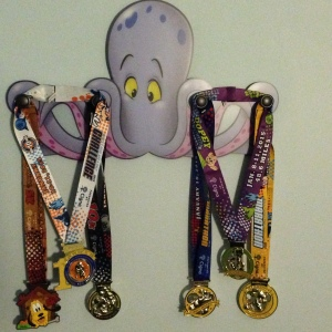 All six of my Dopey Challenge medals on my medal hanger in my hotel room!